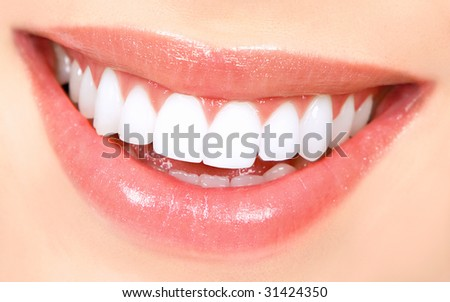 Beautiful young woman teeth. Close up - stock photo