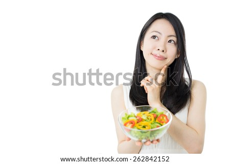 beautiful young woman thinking about salad, isolated on white background - stock photo