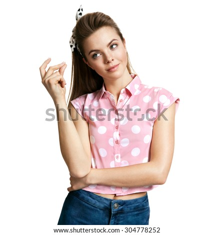 Beautiful young woman thinking and looking towards / photo of young cheerful brunette woman over white background, positive emotions - stock photo