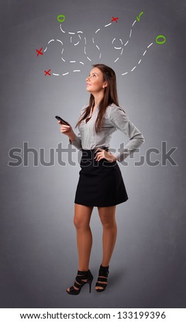 Beautiful young woman thinking with abstract marks overhead - stock photo