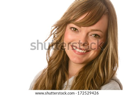 Beautiful Young Woman - This is a portrait of a beautiful young woman smiling. Shot on a white background with a shallow depth of field.