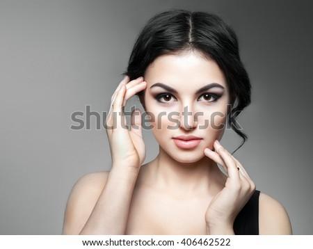 Beautiful Young Woman Touching Her Face - stock photo