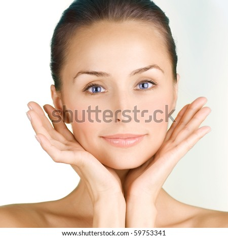 Beautiful Young Woman touching her Face .Clear Skin - stock photo