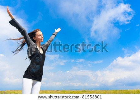 Beautiful young woman under blue sky. Portrait