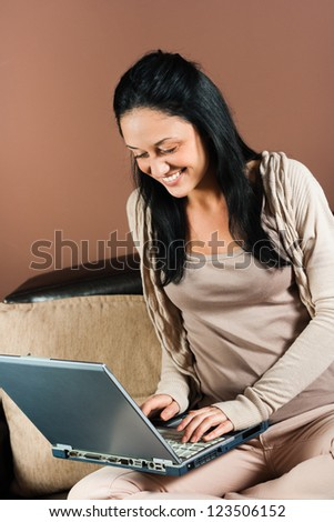 Beautiful young woman using laptop,Young woman with laptop