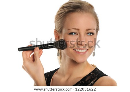 Beautiful young woman using makeup brush isolated over white background