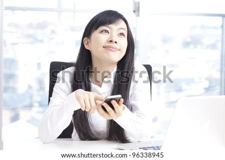 beautiful young woman using smart phone - stock photo