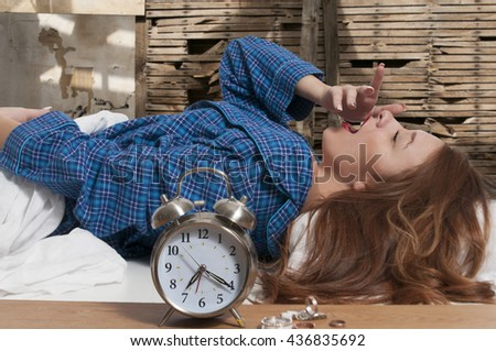 Beautiful young woman waking up or going to sleep