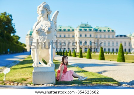 Beautiful young woman walking in Belvedere in Vienna, Austria