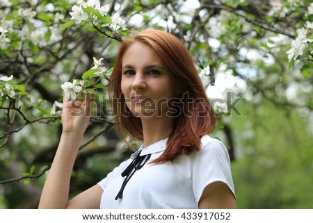 https://thumb9.shutterstock.com/display_pic_with_logo/100037/433917052/stock-photo-beautiful-young-woman-walking-in-park-433917052.jpg
