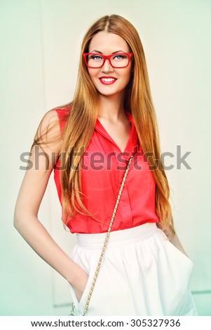 Beautiful young woman walking in the city. Beauty, fashion. - stock photo