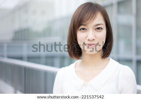 beautiful young woman walking to her office - stock photo