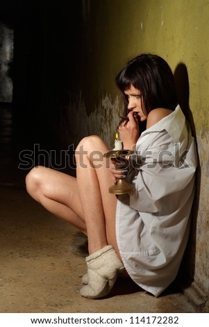 Beautiful young woman was alone in the terrible dark cellar