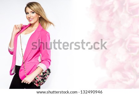 beautiful young woman wearing casual clothes pink jacket and handbag smiling and looking at camera isolated on white background - stock photo