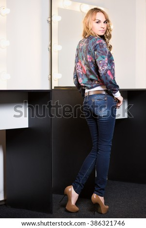 Beautiful young woman wearing fashionable clothes - stock photo