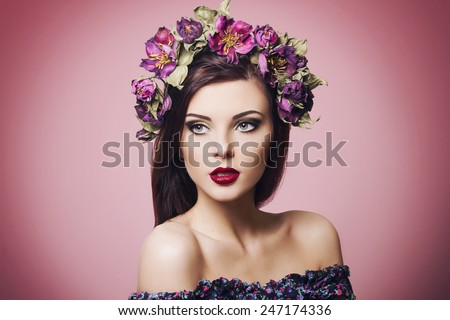 beautiful young woman wearing floral headband and bright makeup - stock photo