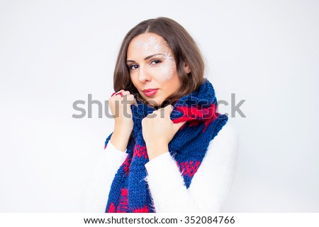 Beautiful young woman, wearing in white sweater , posing with scarf , on the white background, in studio, waist up
