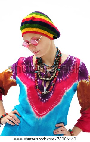 Beautiful young woman wearing rastafarian hat and pink glasses - stock photo