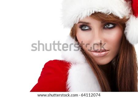 Beautiful young woman wearing santa hat - stock photo