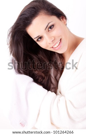 Beautiful young woman wipes her hairs with a towel - stock photo