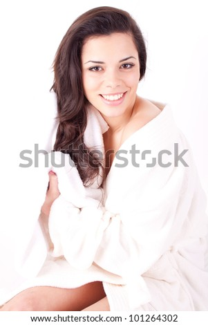 Beautiful young woman wipes her hairs with a towel