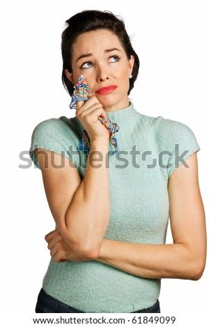 Beautiful young woman wiping tears with handkerchief. 1950's look isolated over white. - stock photo