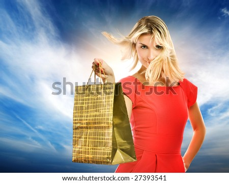 Beautiful young woman with a bag - stock photo