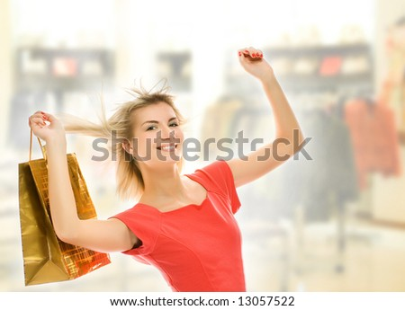 Beautiful young woman with a bag in a shop - stock photo