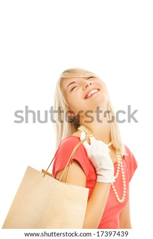Beautiful young woman with a bags. Isolated on white background - stock photo