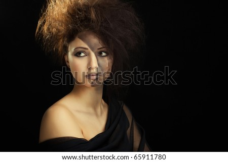beautiful young woman with a bright make-up on a black background - stock photo