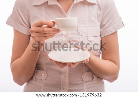 Beautiful young woman with a cup of tea/coffee