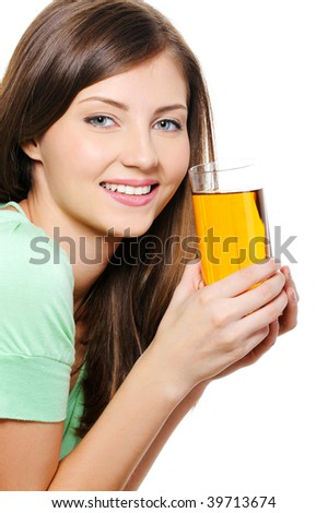 Beautiful young woman with a glass of an apple  juice over white background - stock photo