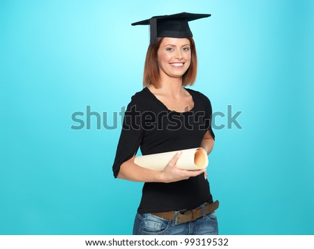 beautiful, young woman with a graduation hat, holding a scroll, on blue background