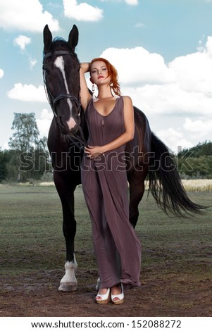 Beautiful young woman with a horse, outdoor - stock photo