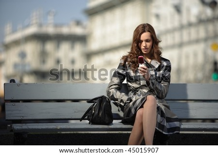 beautiful young woman with a mobile phone - stock photo