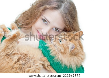 beautiful young woman with a red fluffy cat, isolated on white - stock photo