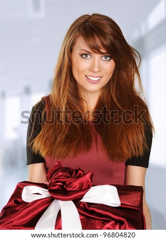 beautiful young woman with a red gift box - stock photo
