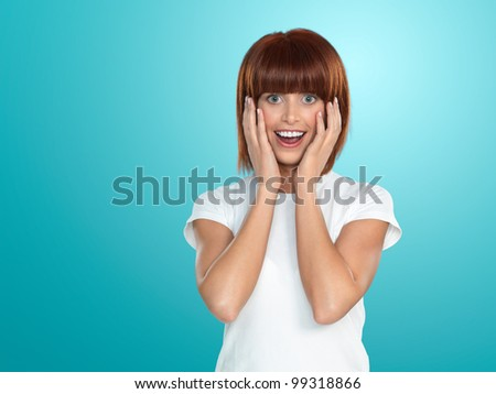beautiful, young woman, with a surprised face expression, on blue background - stock photo