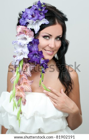 beautiful young woman with a violet flower