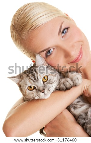 Beautiful young woman with adorable kitten - stock photo