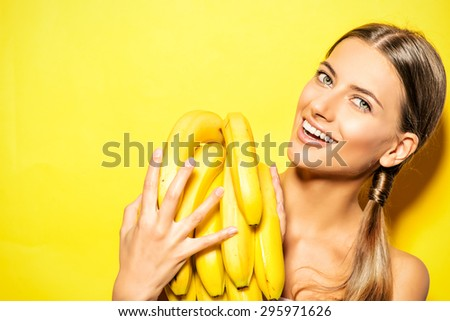 Beautiful young woman with bananas. Tropical fruits. Summer concept. Healthy eating. - stock photo