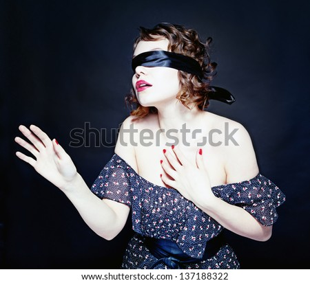 Beautiful young woman with bandage on her eyes - stock photo