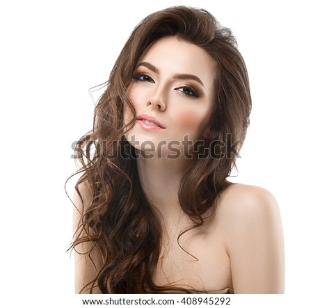Beautiful young woman with beauty long curly hair. Fashion model posing at studio.