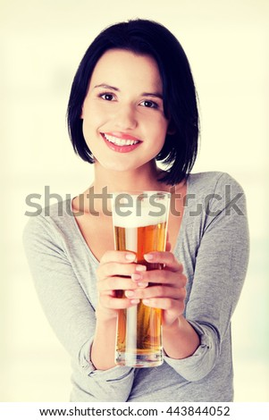 Beautiful  young woman with beer - stock photo