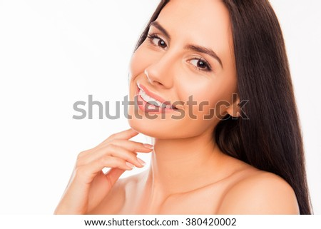 Beautiful young woman with big brown eyes touching her chin - stock photo