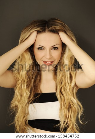 Beautiful young woman with big long blond hair  - stock photo