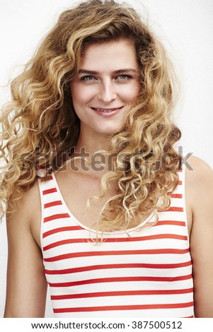 Beautiful young woman with blond curls, portrait