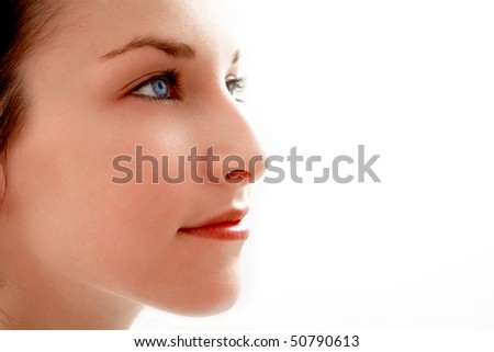 beautiful young woman with blue eyes - face close-up - stock photo