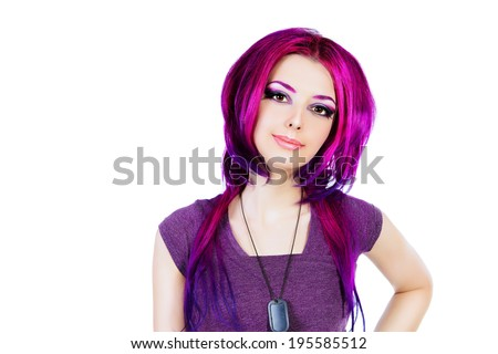 Beautiful young woman with bright crimson hair. Skin care. Hair coloring. Isolated over white.