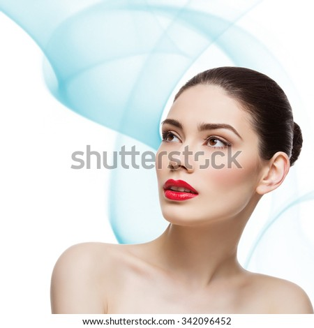 Beautiful young woman with bright red lips. Isolated over smokey white blue background. Square composition. Copy space. - stock photo